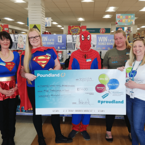 Poundland staff holding a charity cheque